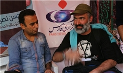 تصویر شهید حججی بر لباس زائر تاجر ترکیه +عکس